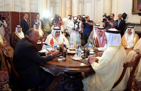 FILE PHOTO: Saudi Foreign Minister Adel al-Jubeir (2-R), UAE Foreign Minister Abdullah bin Zayed al-Nahyan (R), Egyptian Foreign Minister Sameh Shoukry (L), and Bahraini Foreign Minister Khalid bin Ahmed al-Khalifa (2-L) meet to discuss the diplomatic situation with Qatar, in Cairo, Egypt, July 5, 2017.  REUTERS/Khaled Elfiqi/Pool/ File Photo
