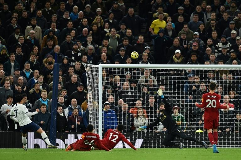 Son rises too high: Son Heung-Min (left) fires over a huge chance for Tottenham against Liverpool