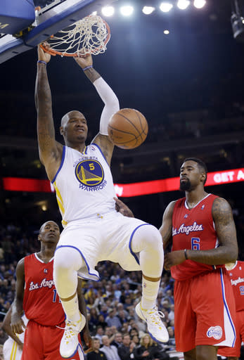 Golden State Warriors' Marreese Speights (5) dunks next to Los Angeles Clippers' Jamal Crawford (11) and DeAndre Jordan (6) during the second half of an NBA basketball game on Thursday, Jan. 30, 2014, in Oakland, Calif. Golden State won 111-92. (AP Photo)