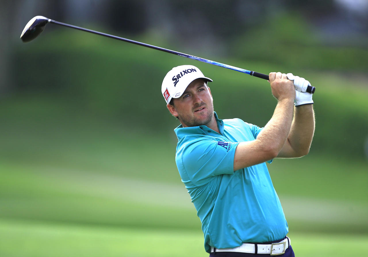 Graeme McDowell, of Northern Ireland, hits a shot from the eighth tee during the second round of the Arnold Palmer Invitational golf tournament at Bay Hill, Friday, March 23, 2012, in Orlando, Fla. (AP Photo/John Raoux)