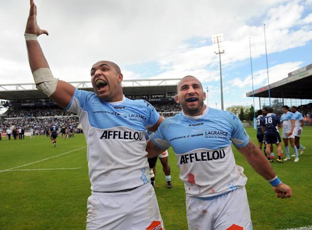 Bayonne's Abdelatif Boutaty (L) and David Roumieu celebrate at the end of the French Top 14 rugby union match Aviron Bayonnais vs. Agen on May 5, 2012 at the Jean Dauger stadium in Bayonne. Bayonne won 31-10. AFP PHOTO GAIZKA IROZGAIZKA IROZ/AFP/GettyImages