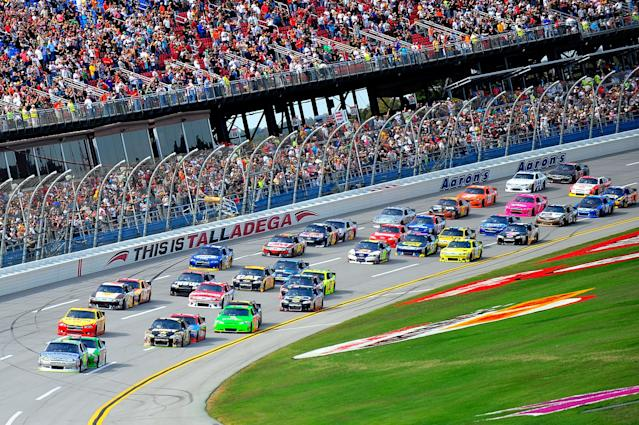 TALLADEGA, AL - OCTOBER 23: Jimmie Johnson, driver of the #48 MyLowe's Chevrolet, leads the field during the NASCAR Sprint Cup Series Good Sam Club 500 at Talladega Superspeedway on October 23, 2011 in Talladega, Alabama. (Photo by Jason Smith/Getty Images)