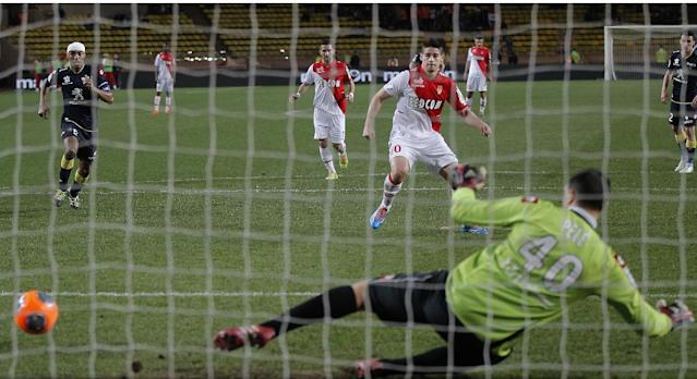 Monaco's James Rodriguez of Colombia shoots a penalty and scores the second goal against Sochaux during their French League One soccer match, in Monaco stadium, Saturday March 8, 2014. (AP Photo/Lionel Cironneau)