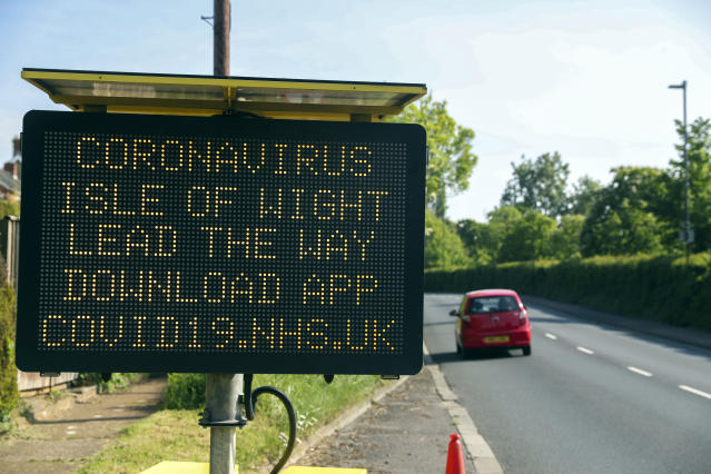A telling people in the Isle of Wight to download the NHS coronavirus contact tracing app. (PA)