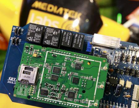 FILE PHOTO: MediaTek chips are seen on a development board at the MediaTek booth during the 2015 Computex exhibition in Taipei, Taiwan