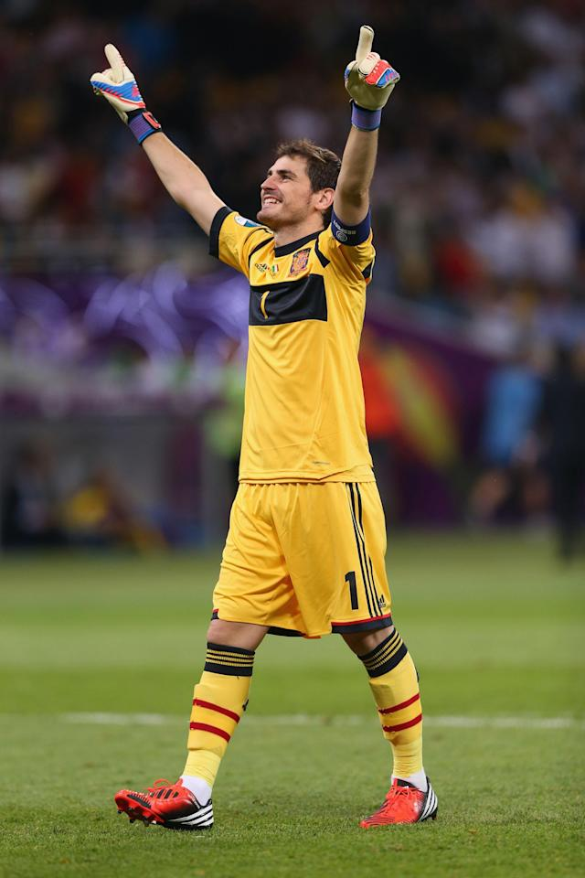 KIEV, UKRAINE - JULY 01: Iker Casillas of Spain celebrates after his team-mate Fernando Torres scored their third goal during the UEFA EURO 2012 final match between Spain and Italy at the Olympic Stadium on July 1, 2012 in Kiev, Ukraine. (Photo by Alex Livesey/Getty Images)