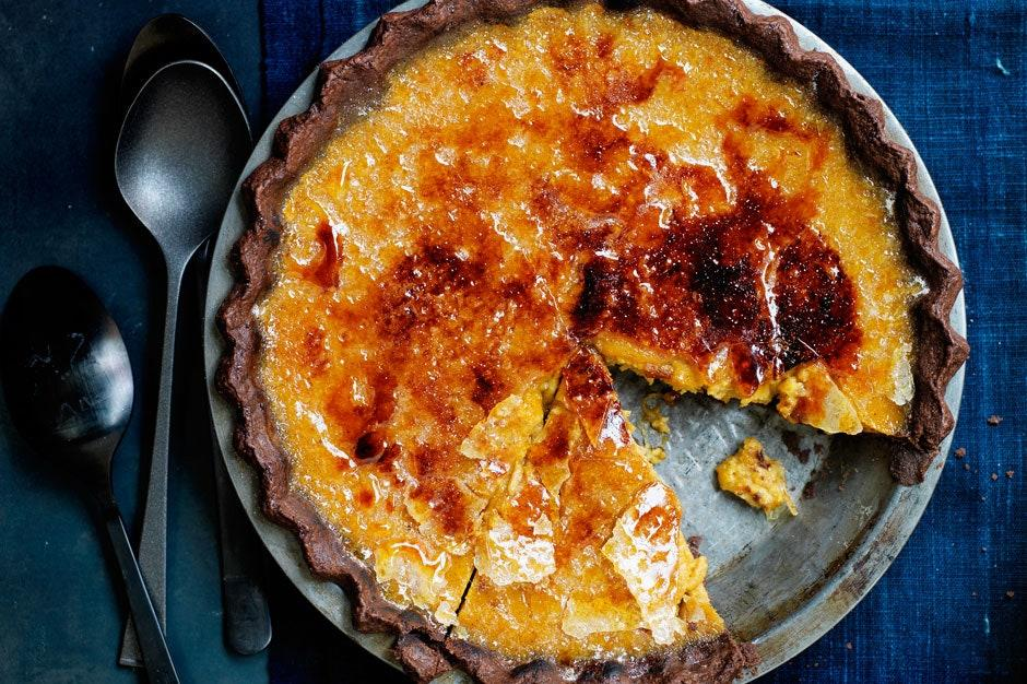 """Is this the best pumpkin pie recipe? The mashup of chocolate crust, pumpkin filling, and crackly bruléed top is sure working hard to make you think so. <a href=""""https://www.epicurious.com/recipes/food/views/bruleed-bourbon-maple-pumpkin-pie-51198720?mbid=synd_yahoo_rss"""">See recipe.</a>"""