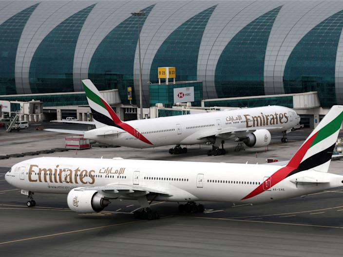 FILE PHOTO: Emirates Airline Boeing 777-300ER planes are seen at Dubai International Airport in Dubai, United Arab Emirates February 15, 2019. REUTERS/Christopher Pike/File Photo