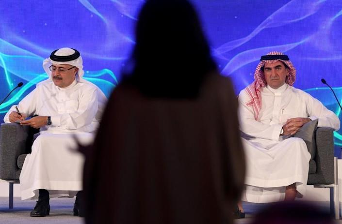 Amin H. Nasser, president and CEO of Saudi Aramco, and Yasser al-Rumayyan, Aramco's chairman, listen to a journalist's question during a news conference in Dhahran