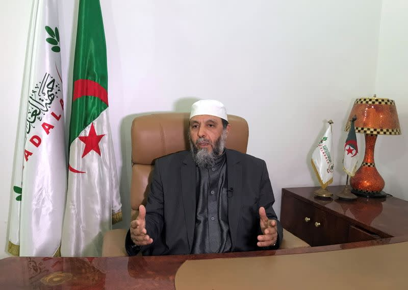 Djaballah gestures during an interview at his office in Algiers