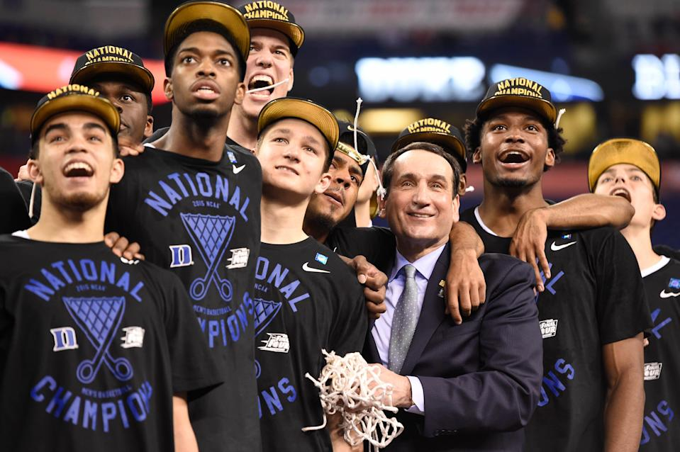 Duke coach Mike Krzyzewski celebrates with his players after defeating Wisconsin in the 2015 NCAA men's basketball championship game at Lucas Oil Stadium on April 6, 2015, in Indianapolis.