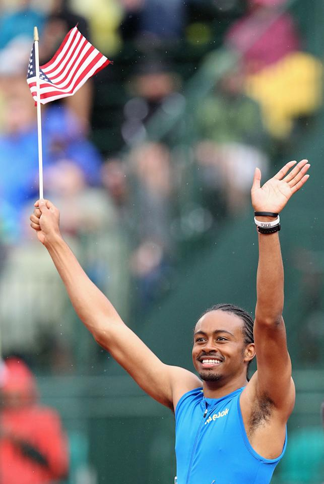 EUGENE, OR - JUNE 30:  Aries Merritt waves to fans in celebration after winning the Men's 110 Meter Hurdles Final on day nine of the U.S. Olympic Track & Field Team Trials at the Hayward Field on June 30, 2012 in Eugene, Oregon.  (Photo by Christian Petersen/Getty Images)