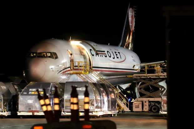 New Brunswick's first shipment of the Pfizer-BioNTech COVID-19 vaccine arrives on a cargo flight from Montreal.