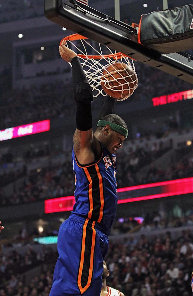 CHICAGO, IL - APRIL 10: Carmelo Anthony #7 of the New York Knicks dunks the ball against the Chicago Bulls at the United Center on April 10, 2012 in Chicago, Illinois. NOTE TO USER: User expressly acknowledges and agrees that, by downloading and or using this photograph, User is consenting to the terms and conditions of the Getty Images License Agreement. (Photo by Jonathan Daniel/Getty Images)