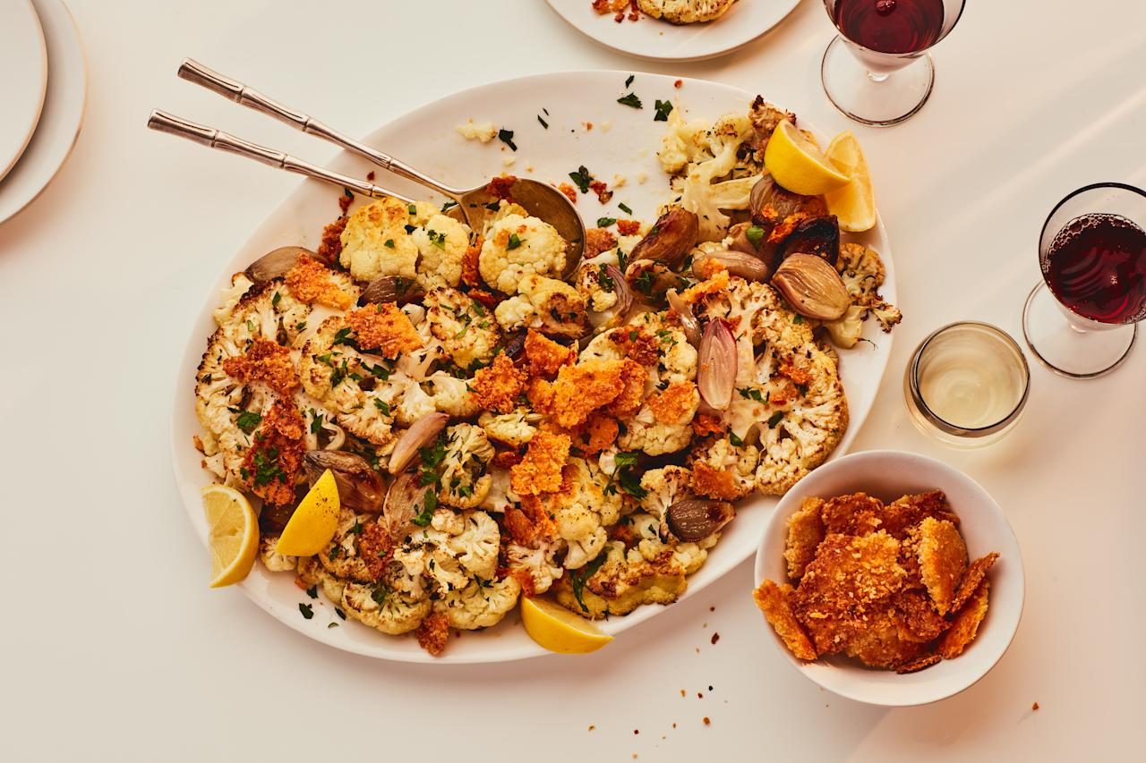 "A make-ahead Parmesan and panko crumble adds an addictive savory crunch to this large-format side dish. Yielding 20 servings, this recipe will feed a crowd. <a href=""https://www.epicurious.com/recipes/food/views/roasted-cauliflower-with-parmesan-panko-crumble?mbid=synd_yahoo_rss"">See recipe.</a>"