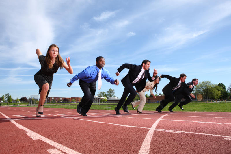 Businesspeople racing on an outdoor track.
