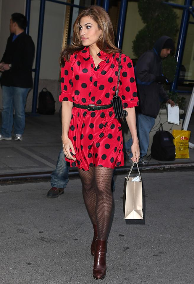 Eva Mendes spotted wearing a bold black and red polka dot dress as she leaves a hotel after having a press junket in New York City
