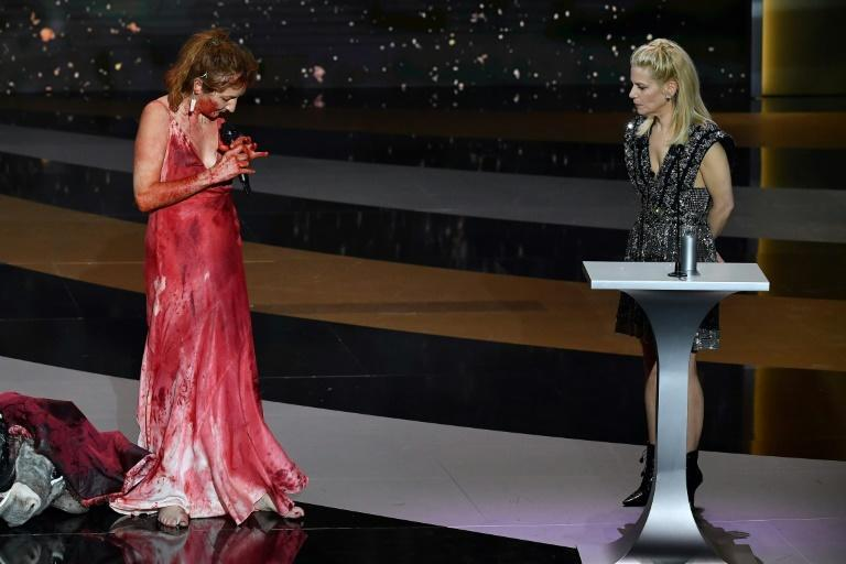 Actress Corinne Masiero (L) appeared to present the award for best costume, later stripping naked on stage in support of artists impacted by lockdowns