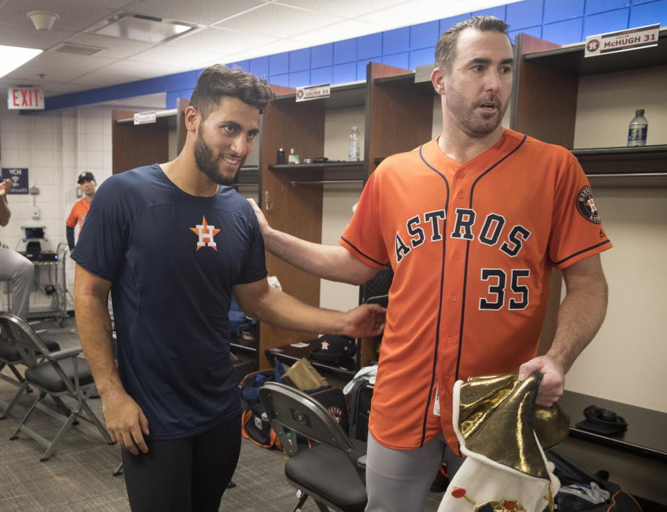 Houston Astros starting pitcher Justin Verlander, right, celebrates in the clubhouse with teammate Abraham Toro after they defeated the Toronto Blue Jays in a baseball game in Toronto, Sunday Sept. 1, 2019. Verlander pitched a no-hitter and Toro hit a go-ahead two-run home run in the ninth. (Fred Thornhill/The Canadian Press via AP)