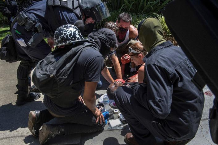 A stabbing victim is attended to during a neo-Nazi rally in Sacramento, Calif.