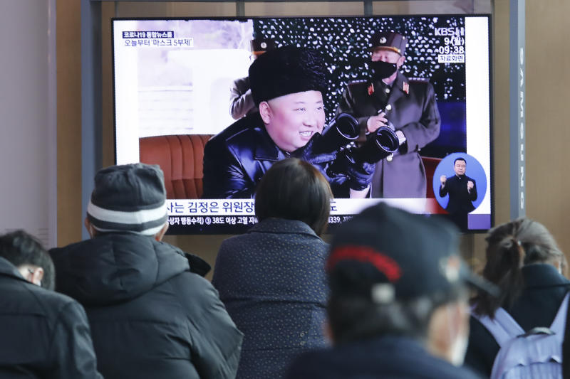 """People watch a TV showing a file image of North Korean leader Kim Jong Un during a news program at the Seoul Railway Station in Seoul, South Korea, Monday, March 9, 2020. North Korea fired three unidentified projectiles off its east coast on Monday, South Korea's military said, two days after the North threatened to take """"momentous"""" action to protest outside condemnation over its earlier live-fire exercises. (AP Photo/Ahn Young-joon)"""