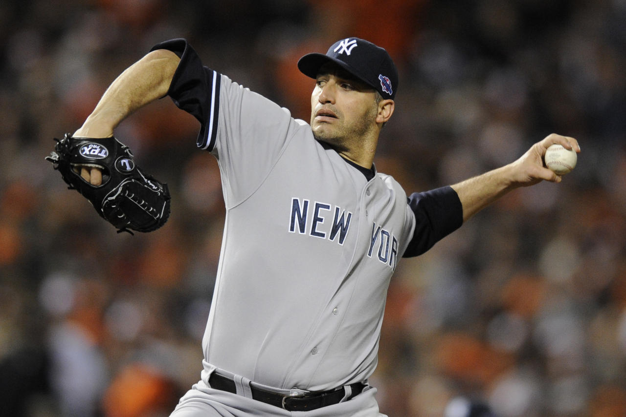 New York Yankees starting pitcher Andy Pettitte throws to the Baltimore Orioles in the first inning of Game 2 of the American League division baseball series on Monday, Oct. 8, 2012, in Baltimore. (AP Photo/Nick Wass)