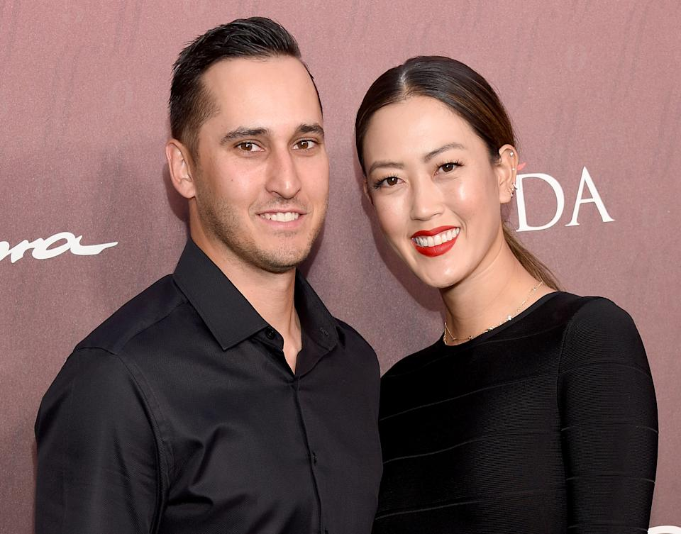 LOS ANGELES, CA - JULY 18:  Michelle Wie and Jonnie West arrive at the Sports Illustrated Fashionable 50 at The Sunset Room on July 18, 2019 in Los Angeles, California.  (Photo by Gregg DeGuire/FilmMagic)