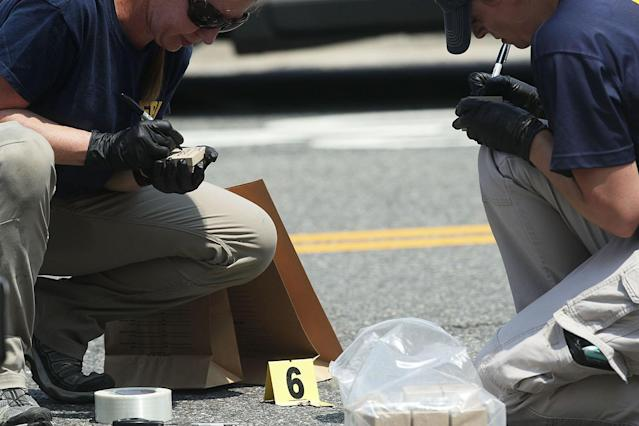 <p>Members of the FBI Evidence Response Team collect info of a piece of evidence at the site of this morning's shooting at Eugene Simpson Stadium Park June 14, 2017 in Alexandria, Va. (Photo: Alex Wong/Getty Images) </p>