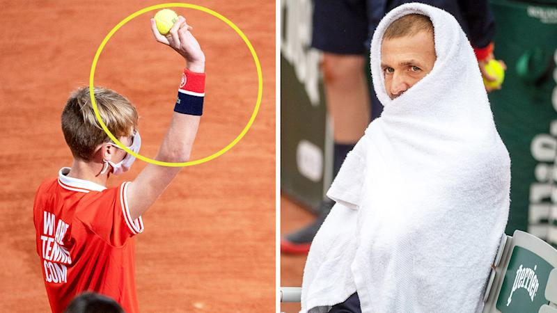 British tennis star Dan Evans (pictured right) keeping warm in cold conditions at the French Open and a ball boy (pictured left) holding a tennis ball.
