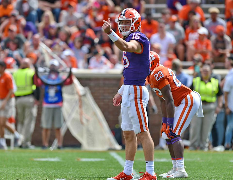 Will college football stars like Clemson's Trevor Lawrence soon be able to profit off their own name, image and likeness? (AP)