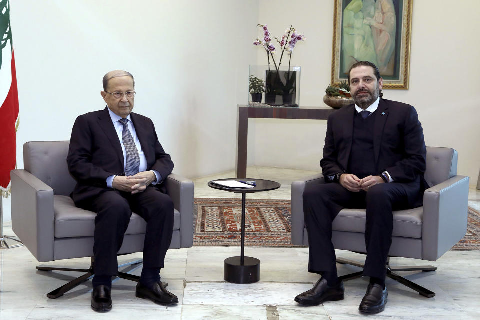 FILE - In this Dec. 19, 2019 file photo, released by Lebanese government, Lebanese President Michel Aoun, left, meets with outgoing Prime Minister Saad Hariri, right, in the presidential palace, in Baabda, east of Beirut, Lebanon. Lebanon's president called Wednesday, March 17, 2021 on the prime minister-designate to form a government immediately or step aside as the country plunges deeper into economic crisis. (Dalati Nohra/Lebanese Official Government via AP, File)