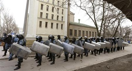 """Ukranian riot police unit """"Berkut"""" stand by during rallies by anti and pro-Yanukovich supporters in the eastern city of Donetsk"""
