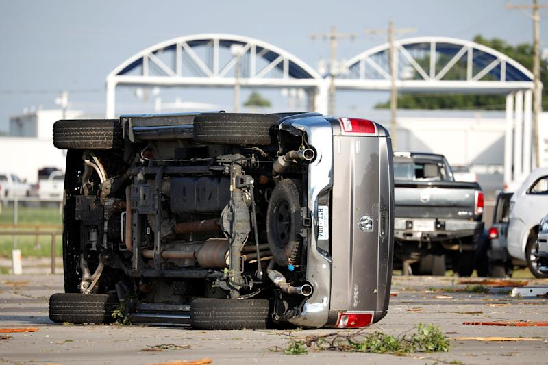 A truck lies on its side at Frontier Car Dealership in El Reno, Okla., on May 26, after a tornado touched down. (Photo: Alonzo Adams/Reuters)