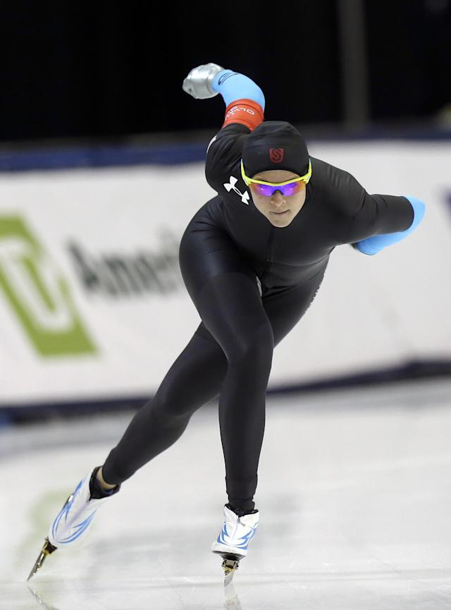 Second-place finisher Brittany Bowe competes in the women's 1,000 meters during the U.S. Olympic speedskating trials on Sunday, Dec. 29, 2013, in Kearns, Utah. (AP Photo/Rick Bowmer)