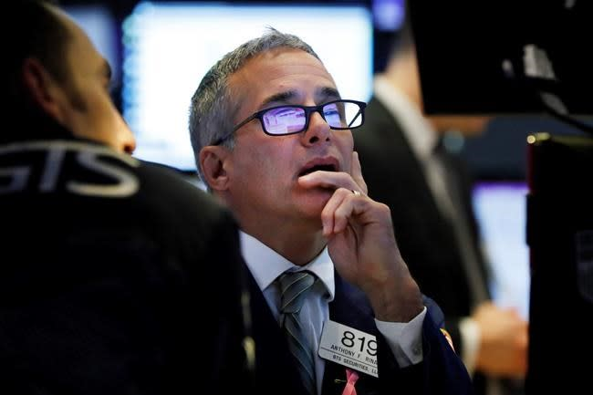 Stocks skid as US raises tensions ahead of China talks