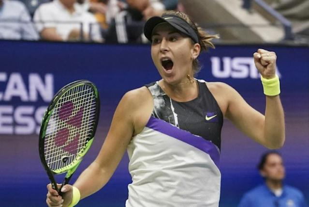 Belinda Bencic celebrates her US Open victory over top-ranked Naomi Osaka on Monday to reach the quarter-finals (AFP Photo/Kena Betancur)