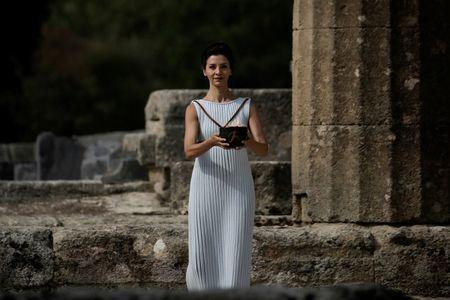 Olympics - Dress Rehearsal - Lighting Ceremony of the Olympic Flame Pyeongchang 2018 - Ancient Olympia, Olympia, Greece - October 23, 2017 Greek actress Katerina Lehou, playing the role of High Priestess, carries the Olympic Flame during the dress rehearsal for the Olympic flame lighting ceremony for the Pyeongchang 2018 Winter Olympic Games at the site of ancient Olympia in Greece REUTERS/Alkis Konstantinidis