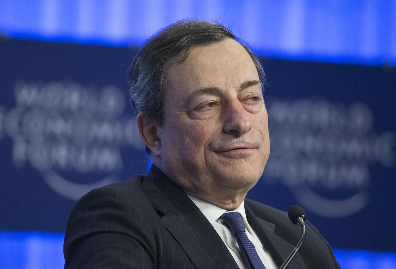 Mario Draghi, President of the European Central Bank, speaks during a session of the World Economic Forum in Davos, Switzerland, Friday, Jan. 24, 2014. (AP Photo/Michel Euler)