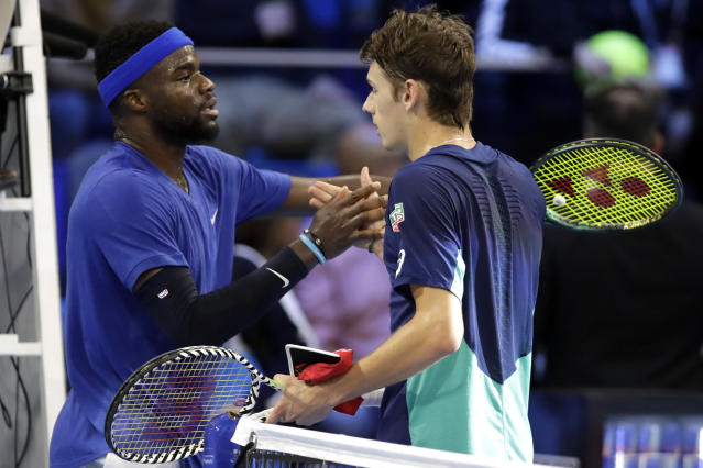 Alex De Minaur, of Australia, right, is congratulated by Frances Tiafoe, of the United States, after winning the ATP Next Gen tennis tournament semifinal match, in Milan, Italy, Friday, Nov. 8, 2019. (AP Photo/Luca Bruno)