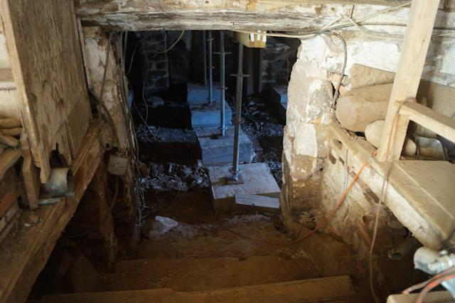 Stairs from the main room lead to a cellar that once had a stream running through it. (Photo: Michael Walsh/Yahoo News)