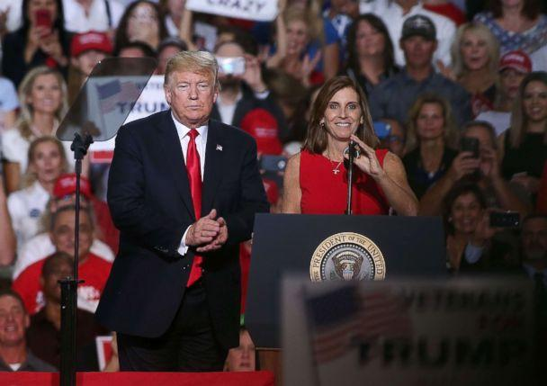 PHOTO: President Donald Trump welcomes Rep. Martha McSally, R-Ariz, to the stage during a rally at the International Air Response facility, Oct. 19, 2018, in Mesa, Ariz. (Ralph Freso/Getty Images, FILE)