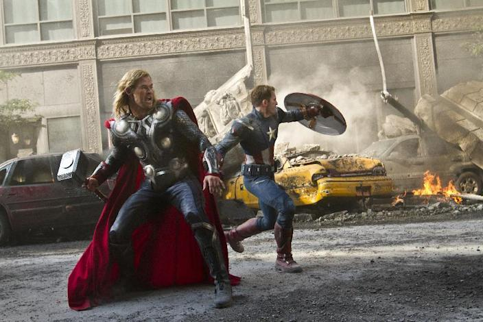 """In this film image released by Disney, Chris Hemsworth portrays Thor, left, and and Chris Evans portrays Captain America in a scene from """"The Avengers,"""" expected to be released on May 4, 2012. (AP Photo/Disney, Zade Rosenthal)"""