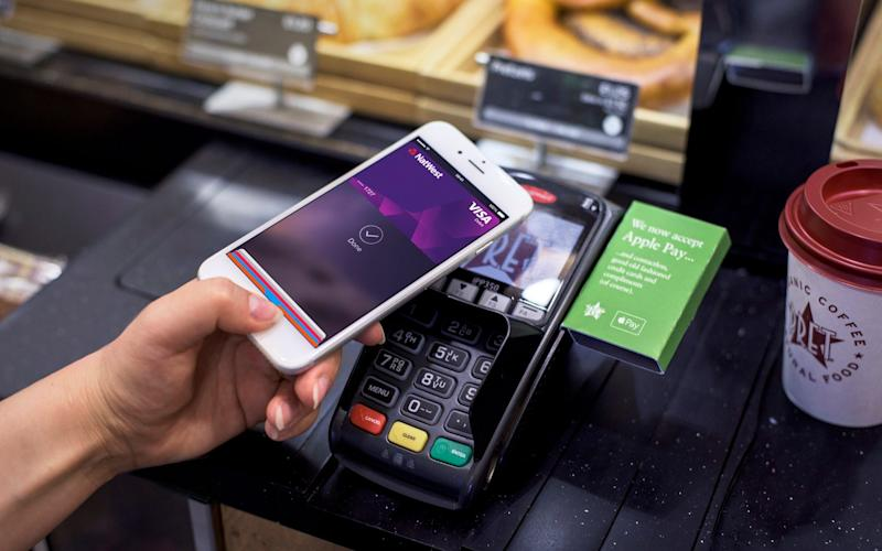 A customer uses Apple Pay to make a purchase at Pret a Manger