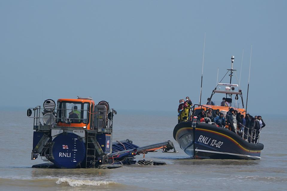 A shore recovery tractor tows the Dungeness lifeboat to the beach after it returned carrying people crossing from France (Gareth Fuller/PA) (PA Wire)