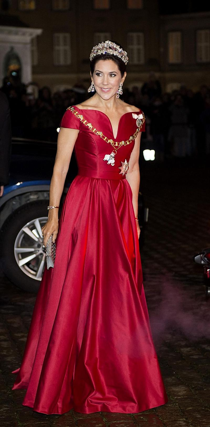Princess Mary has stunned in a red gown at a Danish New Year's Eve party. Photo: Australscope