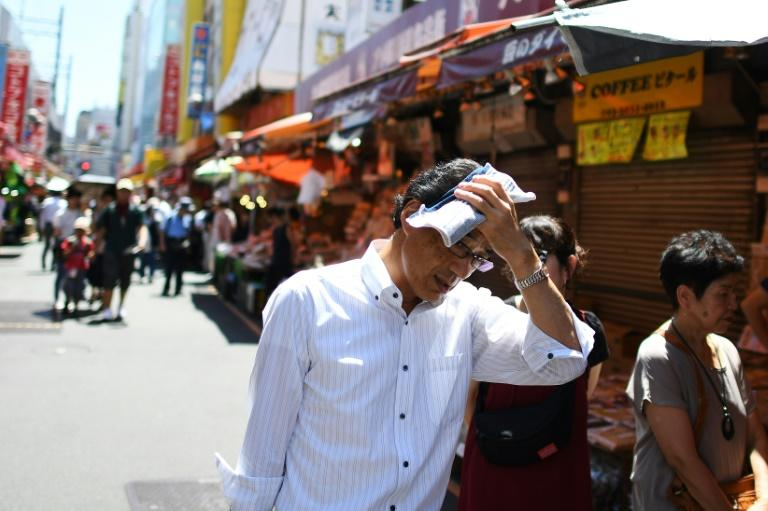 People walk on a hot day in Tokyo, in August 2019 -- average global temperature between 2015-2019 is on track to be the hottest of any five-year period on record, a UN report says