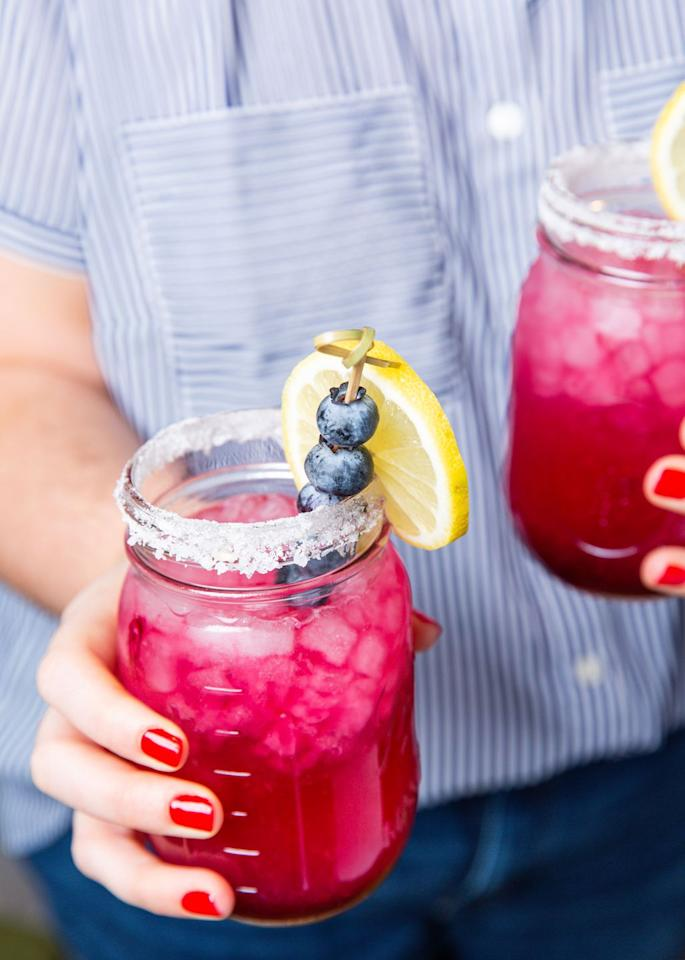 """<p>So fresh and tangy!</p><p>Get the recipe from <a href=""""https://www.delish.com/cooking/recipe-ideas/a21085699/blueberry-lemonade-margaritas-recipe/"""" target=""""_blank"""">Delish</a>.</p>"""