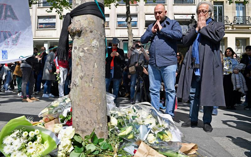 Members of the Muslim community lay flowers following the shooting of a police officer being shot yesterday on the Champs Elysees - Credit: Jeff J Mitchell/Getty Images