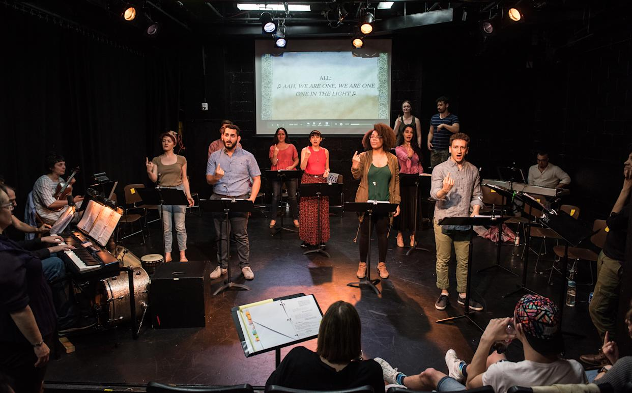 """The cast of """"Stepchild"""" rehearsing at IRT."""