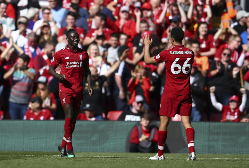 Liverpool's Sadio Mane left celebrates with Liverpool's Trent Alexander Arnold after scoring his side's second goal during the English Premier League soccer match between Liverpool and Wolverhampton Wanderers at the Anfield stadium in Liv